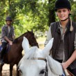 Stock Photo: Couple on horse ride.