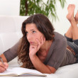 Woman writing in her diary — Stock Photo
