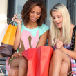 Girls ecstatic after shopping frenzy - Stock Photo