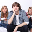 Three teenagers playing computer game — Stock Photo