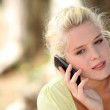 Neutral woman talking on her mobile phone — Stock Photo