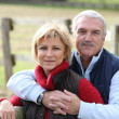 Mature couple outdoors in the autumn — Stock Photo