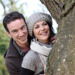Couple by a tree — Stock Photo #8324141