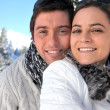 Couple in love at ski resort — Stock Photo