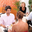 Couples eating in a restaurant — Stock Photo