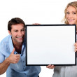 Couple holding up a blank sign — Stock Photo #8324322