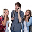 Young on mobile phones — Stock Photo