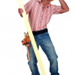 Tradesman trying to protect himself from falling debris — Stock Photo