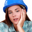 Stock Photo: Tired-looking tradeswoman
