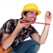 Stock Photo: Plumber crouching under blank copyspace