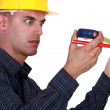Stock Photo: Construction worker impressed by his meter.