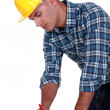 A carpenter taking measures. — Stock Photo #8325119
