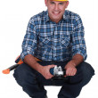 Stock Photo: Mholding angle-grinder