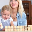 A mother and daughter playing with dominos. — Stock Photo #8325280