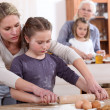 Stock Photo: Little girls baking