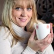 Stock Photo: Portrait of blonde womdrinking hot drink