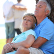 Stock Photo: Mature couple dozing in sunshine