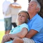Mature couple dozing in the sunshine — Stock Photo #8325497
