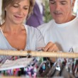 A middle age couple shopping for clothes. — Stock Photo