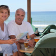 Couple having a drink on holiday — Stock Photo #8325538