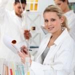 Three women in laboratory — Stock Photo