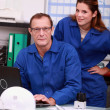 Workers looking up parts on the internet — Stock Photo #8326799