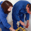 Plumber with young female apprentice — Stock Photo #8326886