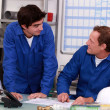Plumbers in an office — Stock Photo #8327241