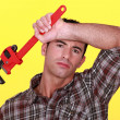 Tired worker holding wrench — Stock Photo #8327522