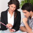 Stock Photo: Two office workers brainstorming