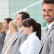 Businessman smiling with team — Stock Photo