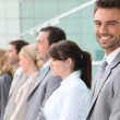 Stock Photo: Businessman smiling with team