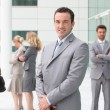 Group of business stood outside building — Stock Photo