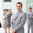 Group of business stood outside building - Stock Photo