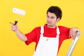Painter on a ladder — Stock Photo