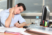 Embarrassed employee at work — Stock Photo