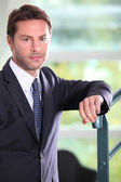 Man in suit on stairwell — Stock Photo