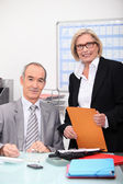 Manger with assistant in office — Stock Photo