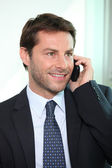 Happy businessman on phone — Stock Photo