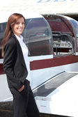 Female pilot and her light aircraft — Stock Photo