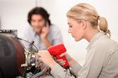 TV repairwoman with a soldering gun — Stock Photo