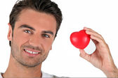Portrait of a man holding a heart — Stock Photo
