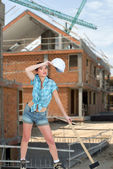Tired female laborer at construction site — Stock Photo