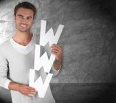 Young man holding the letters WWW — Stock Photo