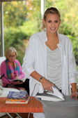 Daughter ironing — Stock Photo