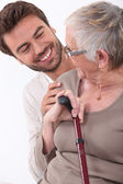 Portrait of a young man and older woman — Stock Photo