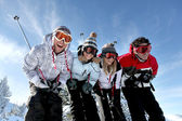 Group of teenagers skiing — Stok fotoğraf
