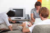 Three pals playing video games. — Stock Photo