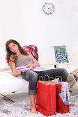 Woman relaxing after shopping — Stock Photo