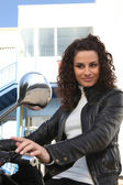 Woman about to ride scooter — Stock Photo